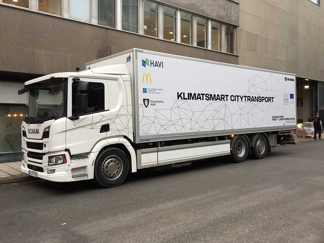 The hybrid truck trialled in Stockholm, Sweden, runs on hydrotreated vegetable oil outside the city and electricity in the centre, and delivered to six restaurants on a single charge. Image credit - Paul Fenton
