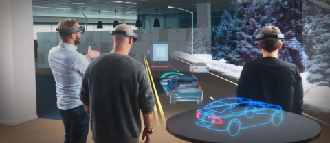 Augmented reality could help teammates discuss projects by displaying objects in front of them. Image credit: Microsoft