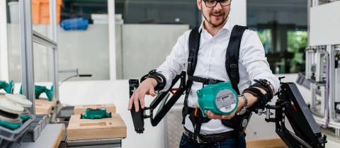 Researchers are developing an exoskeleton prototype that makes it easier to carry heavy loads. Image courtesy of Robo-Mate