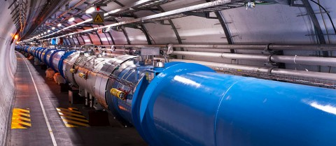 Scientists at CERN's Large Hadron Collider (LHC), the largest particle accelerator in the world, are searching for dark matter by smashing atoms together. 'Views of the LHC tunnel sector 3-4, tirage 2' by Maximilien Brice (CERN) is licensed under CC BY-SA 3.0