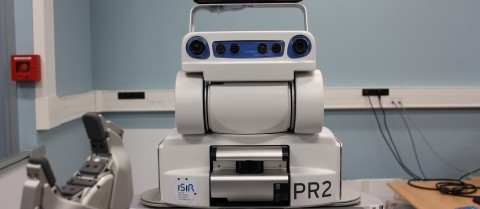 The PR2 robot uses its arms to 'learn' about its surrounding environment. The EU-funded DREAM project is working to create a system where robots like this can 'dream', that is, process information during their down time. Image courtesy of the DREAM consortium