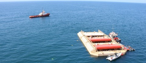 The WaveRoller is taken out to sea on a barge and will sit at the bottom of the ocean and harness wave energy to produce electricity. Image courtesy of WaveRoller