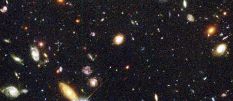 About 1 500 galaxies are visible in this deep view of the Universe, taken by the Hubble Space Telescope. The image covers an area of sky only about the size of a 10 cents coin viewed from 25 metres away. Thanks to the 'Galaxy Zoo' initiative, specialists can rely on passionate citizens to help them classify these galaxies. Since it was set up in 2007, hundreds of thousands of people have helped make such classifications. © Hubblesite.org