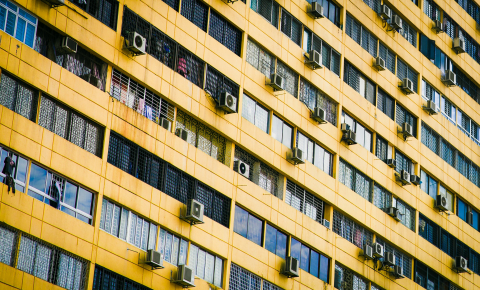 Smart windows that darken or lighten according to temperature to control the amount of heat entering a building could reduce the need for energy-intensive air conditioners. Image credit - Isaac Benhesed / Unsplash