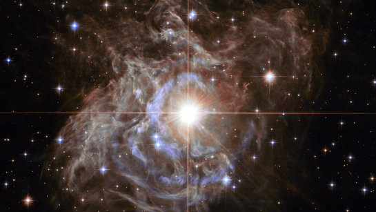 At the centre of the image is an important star called the RS Puppis, a Cepheid variable star which is a class of stars whose luminosity is used to estimate distances to nearby galaxies. This one is 15,000 times brighter than our sun. Image credit - NASA, ESA, Hubble Heritage Team. Acknowledgement - Howard Bond