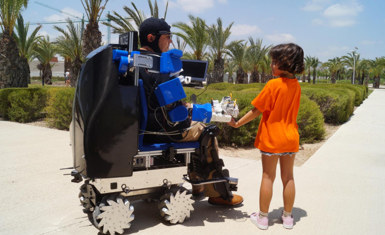 An automated wheelchair with an exoskeleton arm is designed to help people with varying forms of disability carry out daily tasks independently. Image credit - AIDE, Universidad Miguel Hernandez