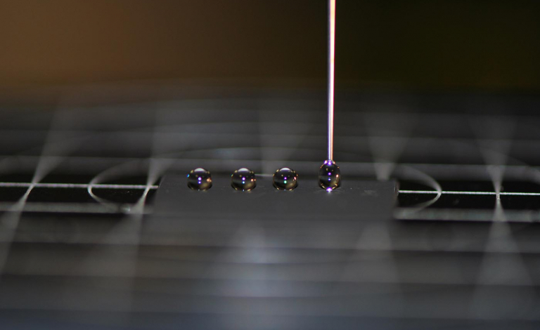 This superhydrophobic surface repels drops of water which forms small balls. Image credit - ALPhANOV