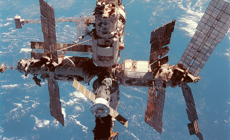 The solar panels for Russia's MIR space station were damaged due to a collision with space debris, making them less effective. Credit: NASA/Crew of STS-91