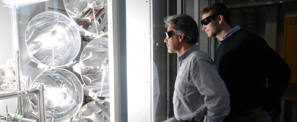 The research team, including Prof. Aldo Steinfeld (left) and Dr Philipp Furler (right), used concentrated light to simulate sunlight in the laboratory. Image courtesy of ETH Zurich