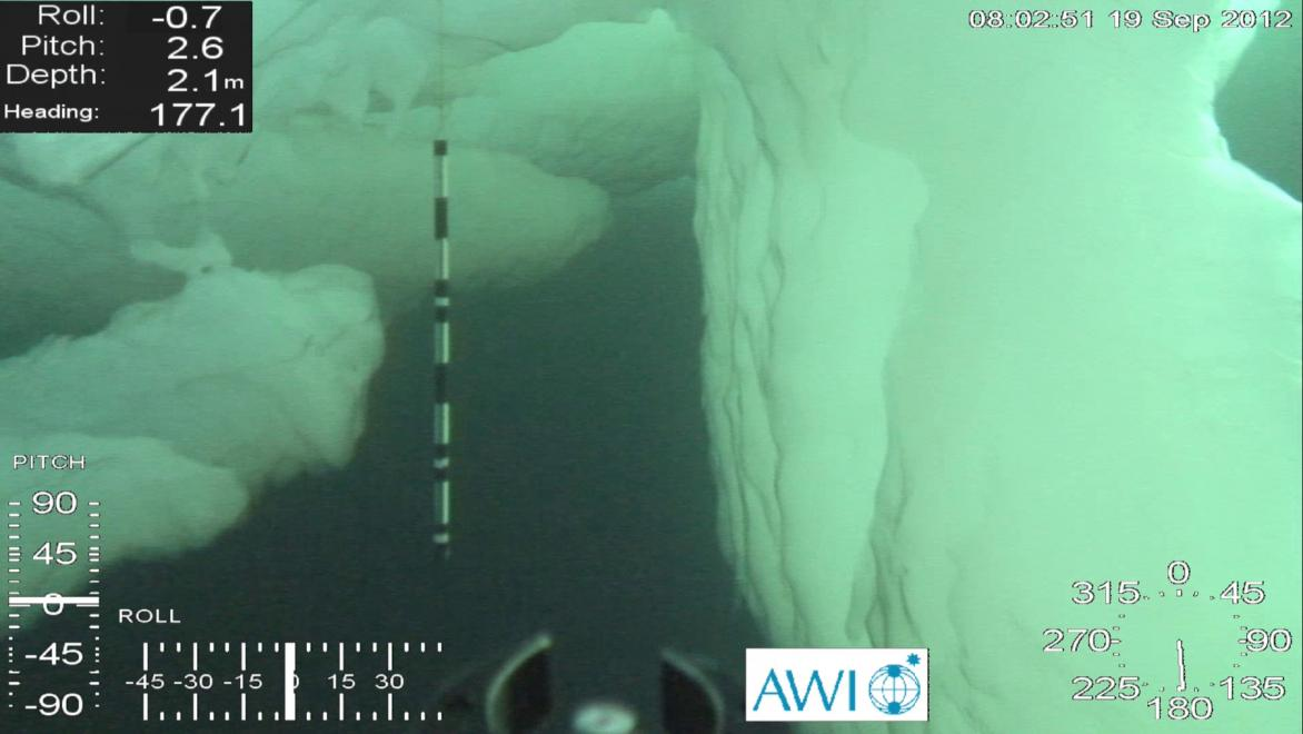 The expedition also took researchers below the ice cover. The scale of the deformed ice is obvious thanks to the one-metre-long guidance marker. Photo: ROV Ronia, Sea Ice Physics Section, AWI
