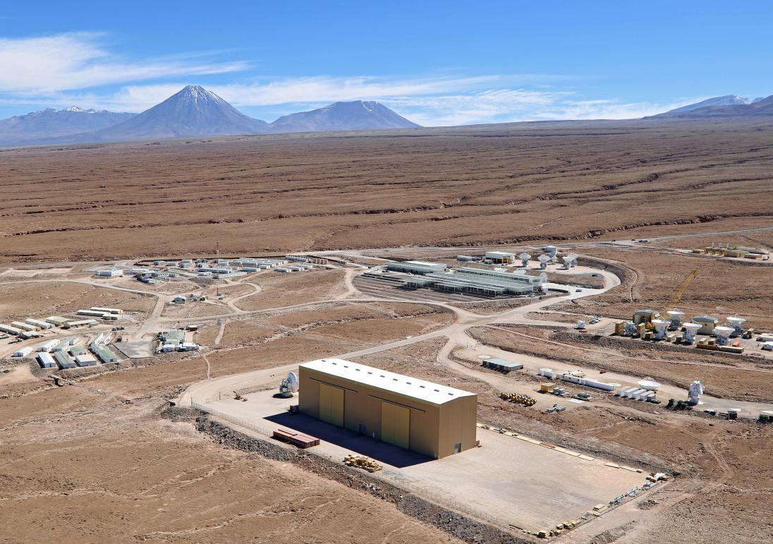 The 'base camp' of the ALMA array, the ALMA Operations Support Facility (OSF), is located some 28 kilometers away, at a much lower altitude of 2900 metres, in the Atacama Desert. This is where the offices, laboratories and telescope control room are located, as well as the site where the antennas are assembled and tested before being taken to their final destination on the Chajnantor Plateau. © ALMA (ESO/NAOJ/NRAO)