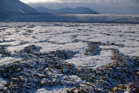Permafrost is soil and sediment that remains continually frozen. About 24 % of the exposed land surface of the Northern Hemisphere is covered by the permafrost; this includes areas of Siberia, Canada, Greenland and Svalbard, an archipelago situated between the north of Norway and the North Pole, pictured here during the month of September. Beneath the frozen ground, vast amounts of carbon are stored in the form of frozen organic matter. Photo: Alfred Wegener Institute (AWI), 2006